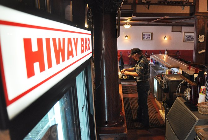 Roger Walker prepares to make a drink at the HiWay Bar. The bar's grand reopening is planned for 5 p.m. Saturday.