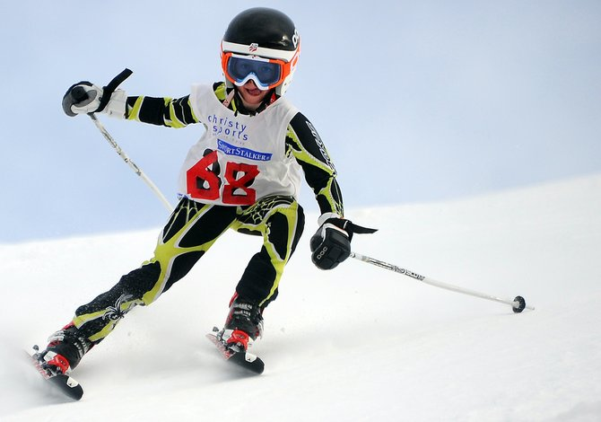 Oliver Rotermund licks his lips as he charges down the giant slalom course at Steamboat Ski Area during a Steamboat Cup event Sunday. More than 100 young skiers took part in the race.