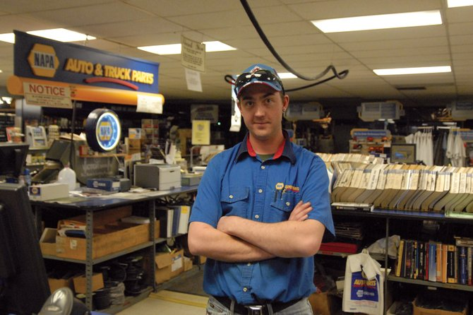 Parts specialist Jesse Aitken closes up shop at T & H Parts, Inc., 400 Taylor St.  Aitken, 30, was born and raised in Craig and said he lives here because he prefers small-town life.