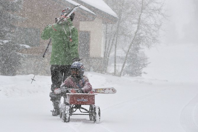 Jeff Olson pulls his daughter Avery, 6, home in a wagon after a day of skiing at Steamboat Ski Area. Skiers and snowboarders were celebrating Monday afternoon as a winter storm brought periods of heavy snow to the area and covered the slopes with several inches of new snow. Tuesday is expected to be colder with no precipitation. Tuesday's forecast has a high of 18 degrees and partly sunny with lows in the single digits.