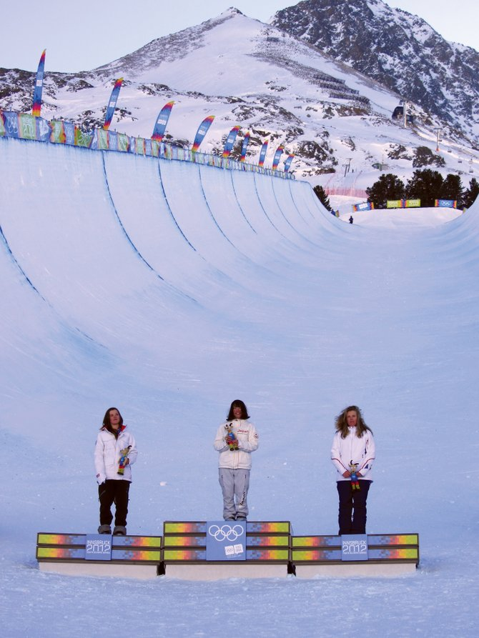 Steamboat Springs snowboarder and silver medalist Arielle Gold, left, gold medalist Hikaru Ohe, of Japan, and bronze medalist Lucile Lefevre, of France, pose for group pictures during the victory ceremony for womens snowboard halfpipe Sunday at the 2012 Winter Youth Olympic Games in Innsbruck, Austria. Gold won the United States first medal.