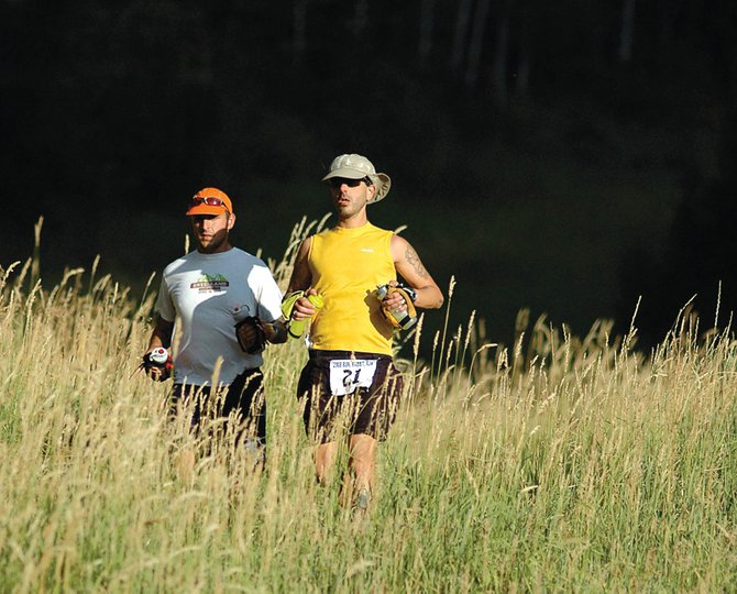 Jake Herman, left, and Frank Anello, both of Denver, jog down Steamboat Ski Area near the Thunderhead Express chairlift  as they near the end of the Run, Rabbit Run Steamboat 50-mile ultramarathon. Race officials say the 2012 version of Run, Rabbit Run will be pushed to 100 miles, a revolutionary change for Steamboat Springs.