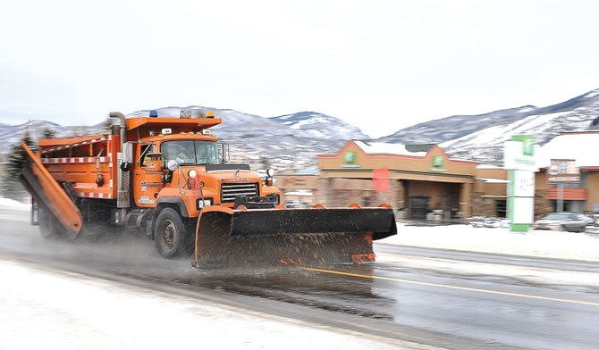 A Colorado Department of Transportation plow clears U.S. Highway 40 on Thursday afternoon. Forecasters were calling for a winter storm to bring snow to the area beginning Thursday evening. Although the storm brought little accumulation to the ski area, another storm is forecast to bring more snow this weekend. 