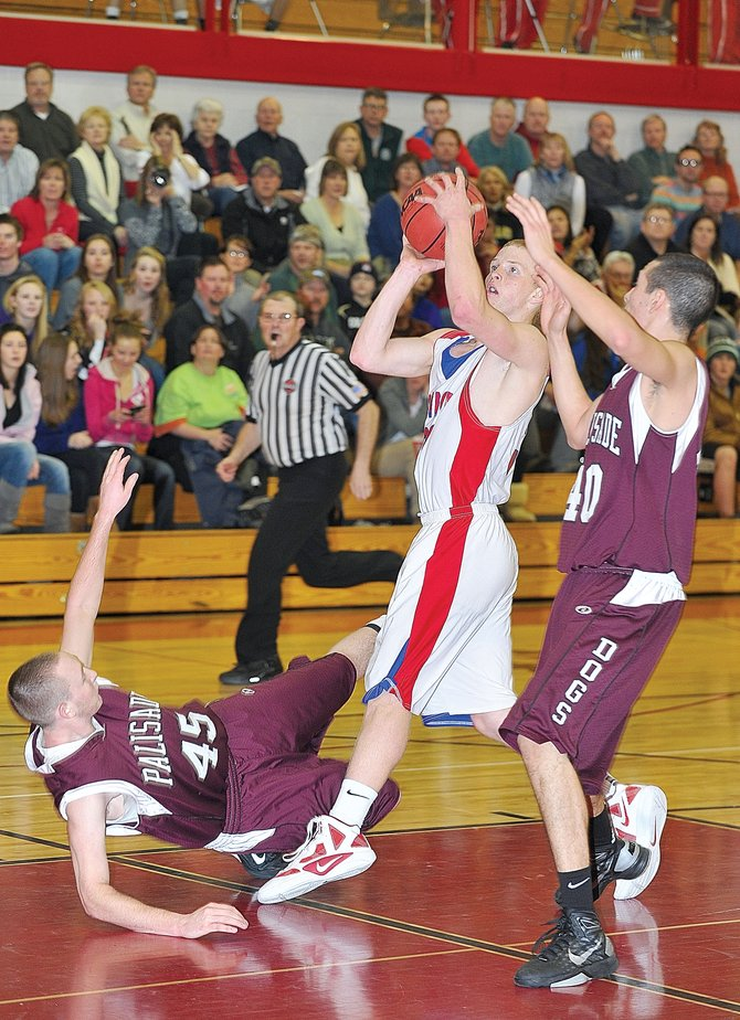 Steamboat senior Kit Croop attempts to make a shot after getting fouled in the first quarter of Friday night&#39;s boy&#39;s high school basketball game between Steamboat and Palisade.