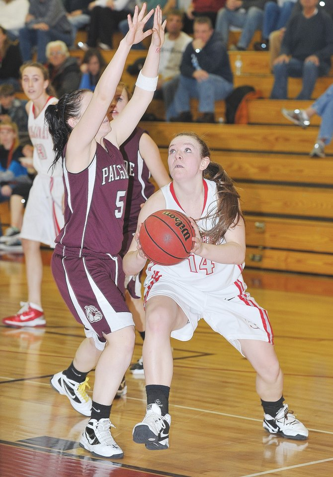 Steamboat junior Nikki Fry drives for a basket in the second half of Friday night&#39;s girls high school basketball game between Steamboat and Palisade.
