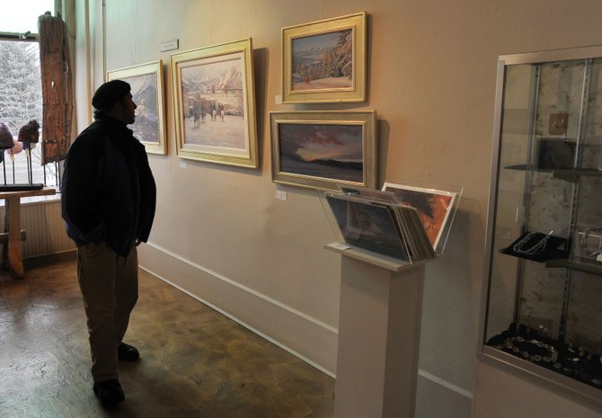Mark Christopher checks out some of the paintings at the Artists' Gallery of Steamboat on Friday afternoon. Many local art galleries are reporting strong winter sales.