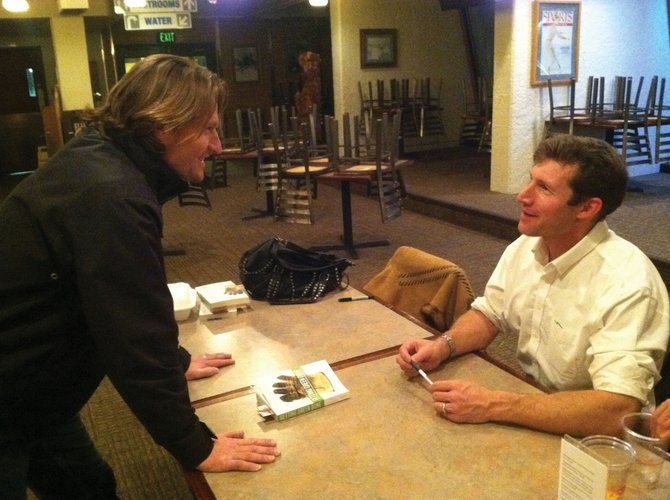 Aspen Skiing Co. Director of Sustainability Auden Schendler, right, talks with Bear River Bar &amp; Grill Manager Julian Bristow after his presentation, Great Hope, Great Fear: Climate Change and Meaning, during the Yampa Valley Sustainability Councils Talking Green Lecture on Tuesday night at the Bear River. Schendler signed copies of his book, Getting Green Done: Hard Truths From the Front Line of the Sustainability Revolution, after the event.