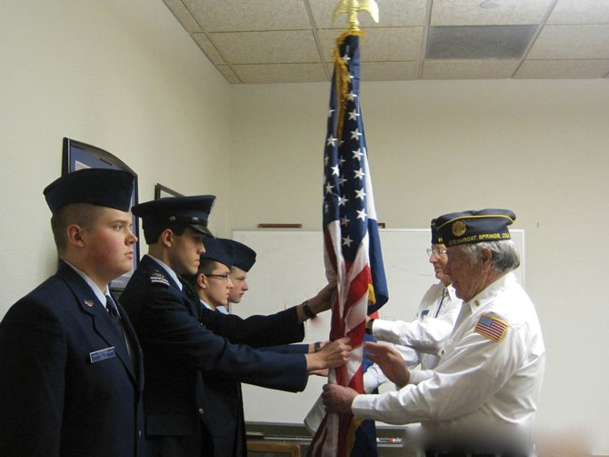 Civil Air Patrol Steamboat Springs Composite Squadron cadets, from left, are Cadet Senior Airman Joshua Heald, Cadet Second Lieutenant Noah Gibbs, Cadet Senior Master Sergeant Aidan Gibbs and Cadet Airman First Class Anthony Sisto. Presenting the American flag is American Legion Post No. 44 Commander Buck Buckland, and presenting the Colorado flag is American Legion Honor Guard Member Van Fletcher.