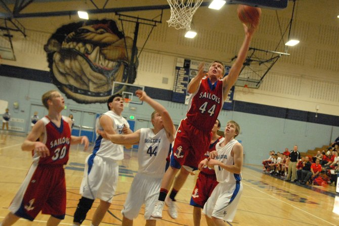 Steamboat senior Jake Miller puts in a layup Tuesday amid Moffat County defenders. Miller led the Sailors to a 54-32 victory with 17 points.