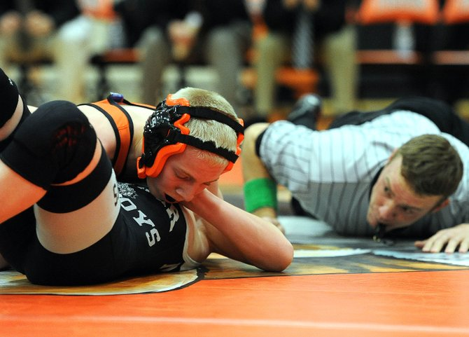 Hayden freshman Tanner Guire wrestles Thursday against Meeker's Tristin Pelloni. Guire won the match, 15-8.