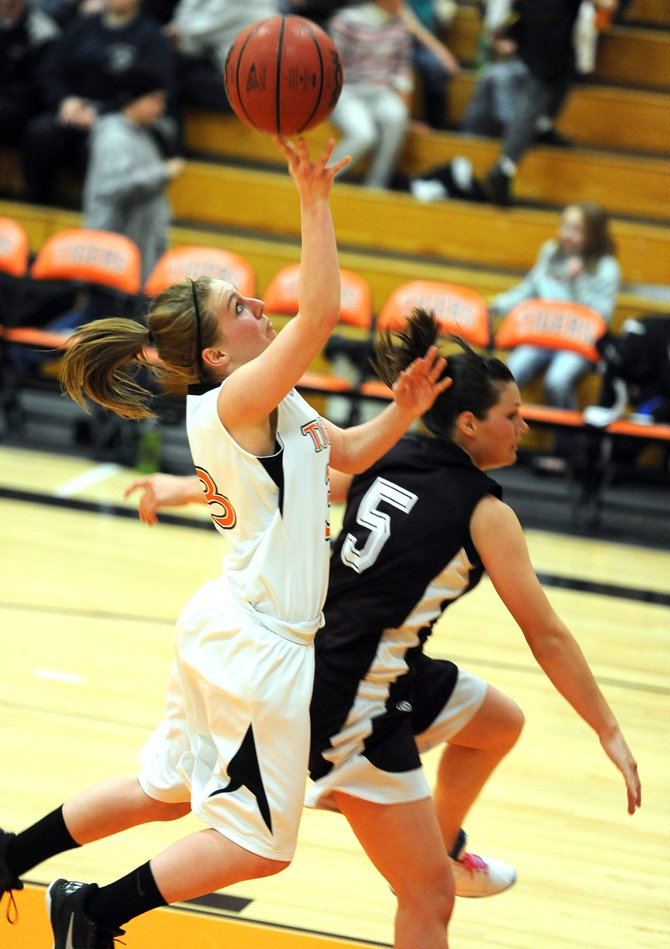 Hayden's Brette Frentress puts up a layup on a fast break Friday. The Tigers were able to beat Soroco, opening up a big lead in the second half.