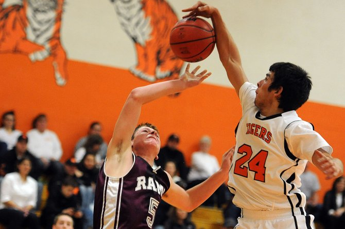 Hayden's Jorge Valdez swats Soroco guard Matthew Regan's shot Friday. The Tigers got up big on the Rams in the second half and won comfortably.
