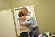 "Don Myers, newly elected chairman of The Memorial Hospital Board, gives a hug to outgoing board member Missy Bonaker at her last board meeting Thursday night. ""I think she was a valuable member of the hospital board, and we're going to miss her,"" he said of Bonaker before the meeting."