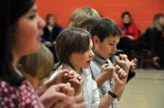 Lane Ferguson, center, a Sunset Elementary School fifth-grader, dances with a group of his classmates during a program Friday morning at the school. Sunset Elementary students in fifth- through first-grades danced for an audience of parents in a series of performances Friday.