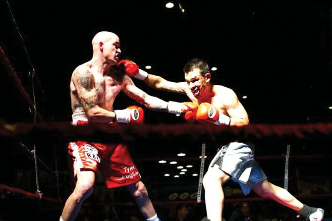 Tyler Pogline, left, a 1998 Moffat County High School graduate, fights Raul Carrillo on Oct. 14, 2011, in Sheridan. Pogline gets back in the ring today against undefeated Cletus Seldin at the Paramount Theatre in Huntington, N.Y.