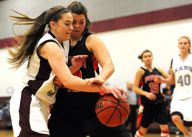 Soroco's Jacey Schlegel tries to drive around a Paonia defender Saturday. That didn't happen too often, the Eagles ratcheting up their full-court defense to force turnovers throughout the game. Although the Rams kept the score close early and reasonable throughout, they fell 62-43.