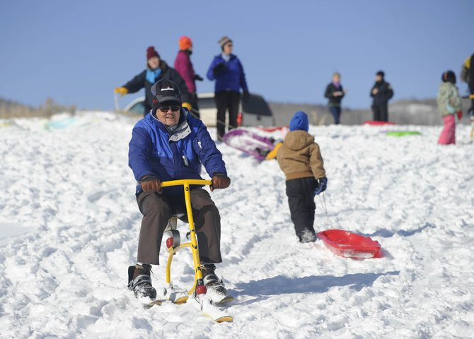 Eph Holmes rides a ski bike Saturday during the Cure Your Cabin Fever event at Stagecoach State Park.