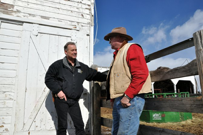 Gary Nichols, livestock investigator for the Moffat County Sheriff's Office, chats with local rancher and longtime friend Dave Seely on Friday. Nichols was recognized Jan. 12 as the 2011 Officer of the Year by the Colorado Cattlemen's Association.
