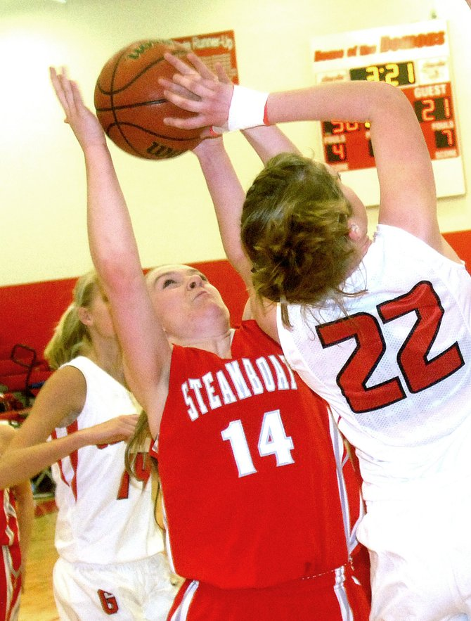 Steamboat Springs High School junior Nikki Fry defends against Glenwood Springs shooter Kenzie Nelson-Buehler in Saturday's game in Glenwood Springs.