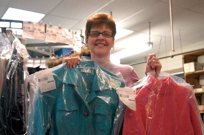 Betty Barnes displays several outfits brought in by customers of her business, Loyd's Cleaners, 522 Breeze St. Barnes, 60, lives in Hayden with her husband and commutes regularly to Craig.