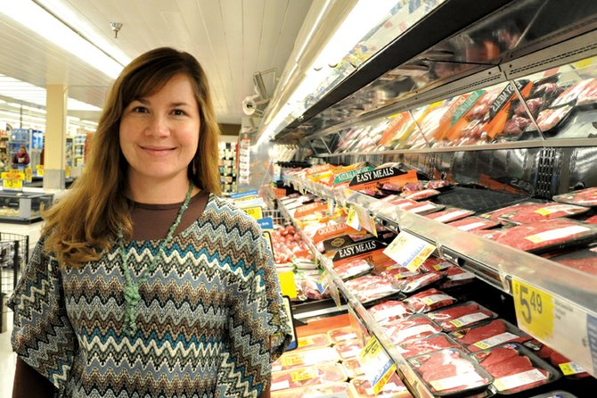 Christina Rhyne, a Moffat County Cattlewomen member, stands in the meat department at City Market in Craig, where she does beef promotional demonstrations for the group. The Colorado Cattlewomen's Association named Rhyne its Rookie of the Year at its Jan. 17 banquet in Denver.