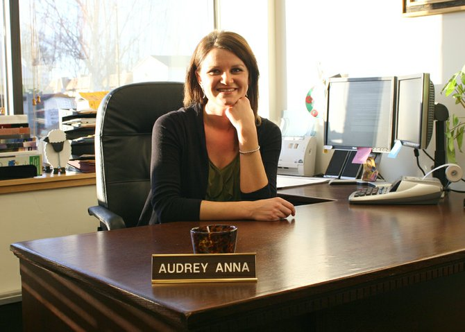 Audrey Anna Charchalis in her office at Bank of Colorado. In addition to dedicating herself to her profession, Charchalis believes in the importance of family and giving back to the community that has provided her with many opportunities.