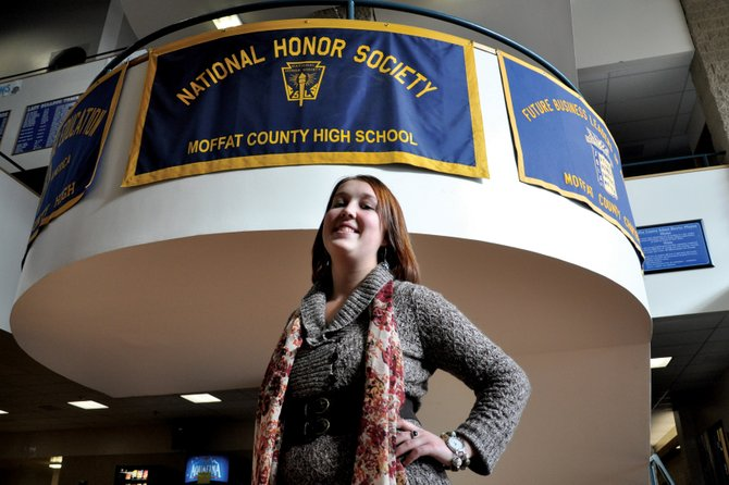 Kirstie McPherson, a Moffat County High School senior, stands underneath the banner for the school's National Honor Society, of which she is a member. McPherson, 18, also is involved in the MCHS Distributive Education Clubs of America, Key Club and Stopping Abuse Forever, or SAFE, which works in partnership with Advocates-Crisis Support Services.