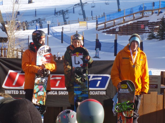 Steamboat Springs snowboarder Nik Baden, center, celebrates after winning a slope-style event in Breckenridge during the weekend. Baden also won in half-pipe.