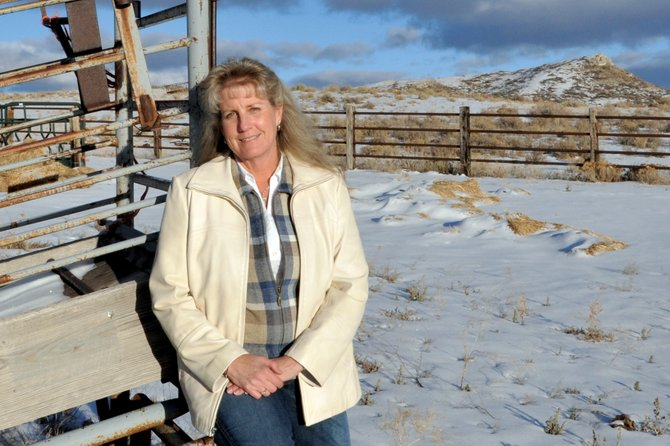 "Jean Stetson, a longtime Moffat County resident, sits on a loading chute at her property west of Craig. Jean served as an advocate for landowners on a local sage grouse working group and helped her husband, Frank ""Pud"" Stetson, run the ranch they owned near Maybell.  ""We worked side by side for 30 years,"" she said."