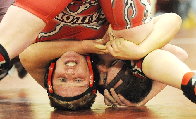 Steamboat Springs sophomore Brandon Yeager and Soroco's Cody Constine grapple for position Thursday in a 182-pound match at the Routt County Triangular wrestling meet at Soroco High School. The pair fought one of the best matches of the night, 9-8, Yeager only logging the go-ahead point with a takedown with 10 seconds remaining in the third period.