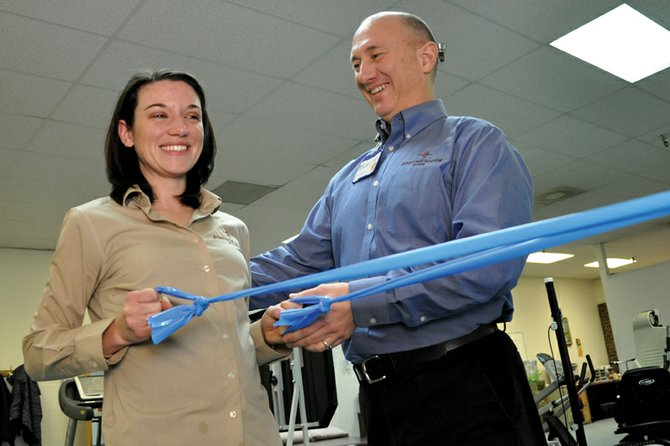 Dale Little, right, physical therapy manager for The Memorial Hospital in Craig, and physical therapist Rachael Thomason demonstrate how to use a Thera-Band, a tool therapy patients can use at home, in the hospital's rehabilitation center inside Centennial Mall. George Rohrich, TMH chief executive officer, opened bids Friday for a renovation project that will enable the hospital to move its physical and occupational therapy services to TMH Medical Clinic.