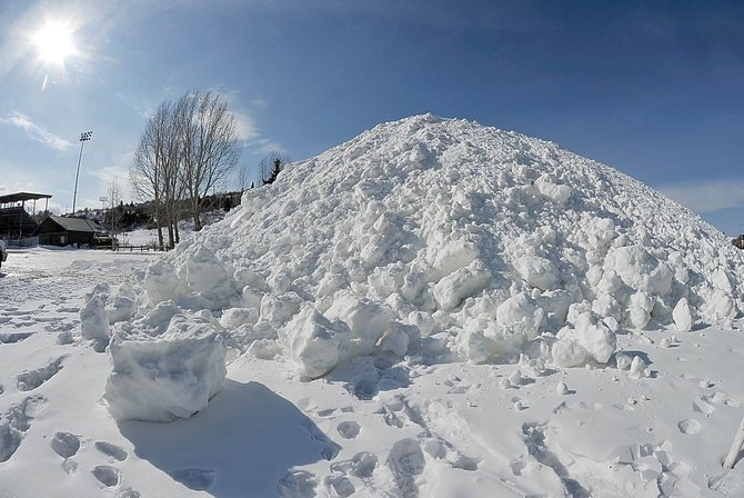 A large pile of snow sits Monday in the parking lot of the Brent Romick Rodeo Arena. The city of Steamboat Springs has been busy making and farming snow for this weekend's Winter Carnival street events.