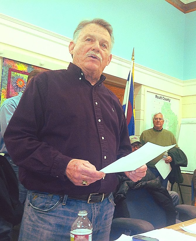 Routt County Republican Chairman Chuck McConnell explains the caucus process at the Routt County Courthouse where six Steamboat precincts were meeting Tuesday night. Mitt Romney handily won the presidential preference poll in Routt County.