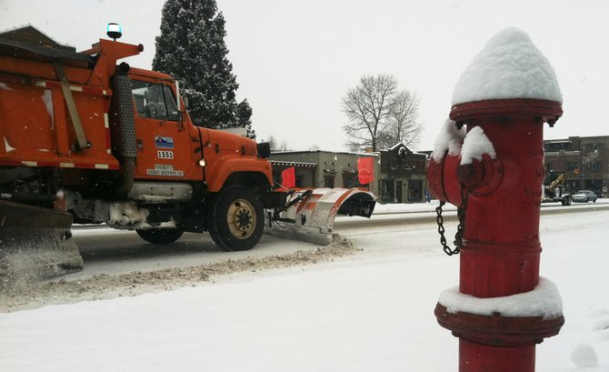 A snowplow clears Lincoln Avenue through downtown Steamboat Springs on Thursday morning. Snowfall of 6 inches at the Steamboat Ski Area was good news for skiers and riders. 
