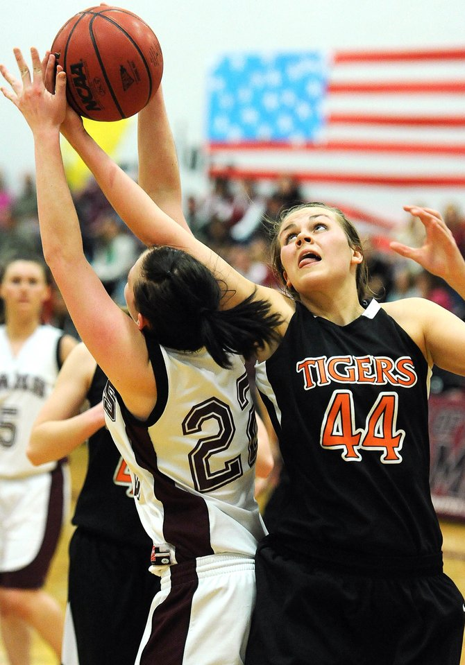 Hayden's Erin Koehler pulls down a rebound from Soroco senior Shelby Miles' arms Friday. Koehler had 18 points and fellow Hayden forward Aubree Haskins finished with 17. Their big night was enough to overcome 19 points from Soroco's Madison George.