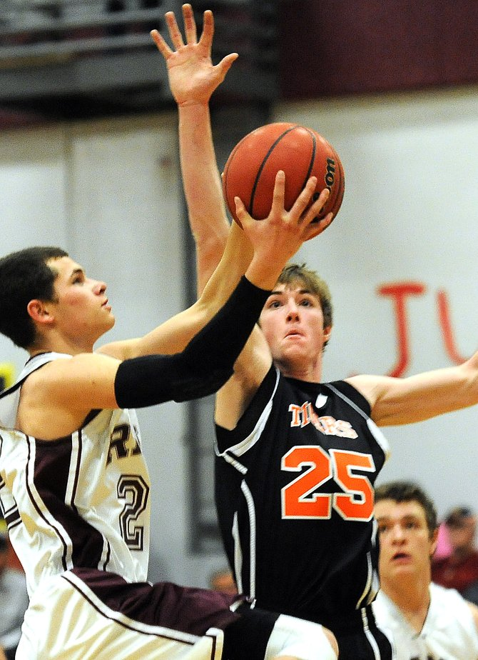 Hayden&#39;s Mark Doolin plays defense on Soroco&#39;s Nic Paxton on Friday in Oak Creek. The Tigers got up big early to take down the Rams for the second time this season.