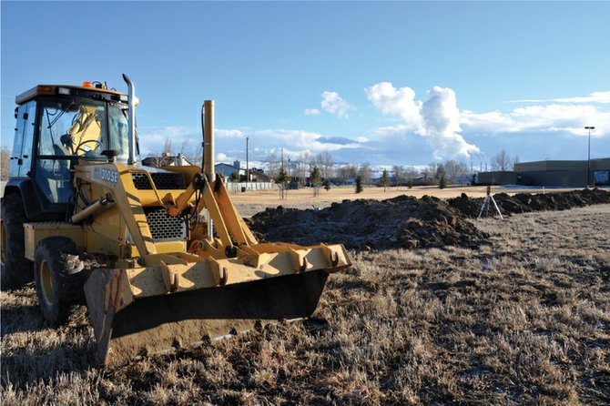 A backhoe sits Thursday on the future site of the Tebo Center east of Walmart Supercenter as a crew broke ground on the facility this week. The 10,477-square-foot retail space is one of several new business developments on Craig's economic horizon.