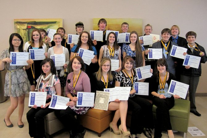 Moffat County High School students who competed in a Future Business Leaders of America district competition Monday display awards they won during the event in Grand Junction. Of the 20 students who participated in the event, 17 qualified for state.