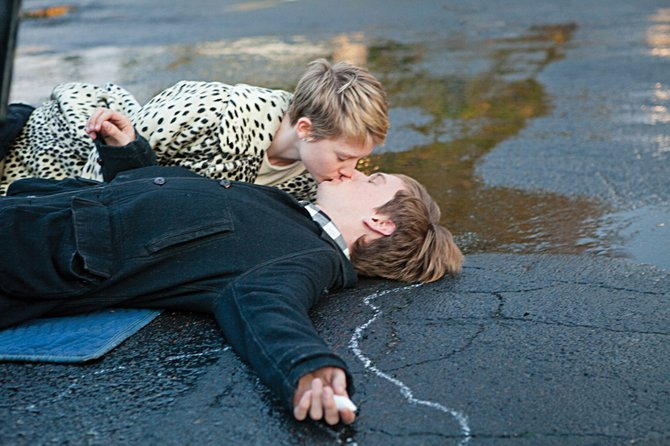 "Young lovers Annabel (Mia Wasikowska) and Enoch (Henry Hopper) share a kiss in ""Restless."" The 2011 film is a tale of young man who falls for a terminally ill girl."