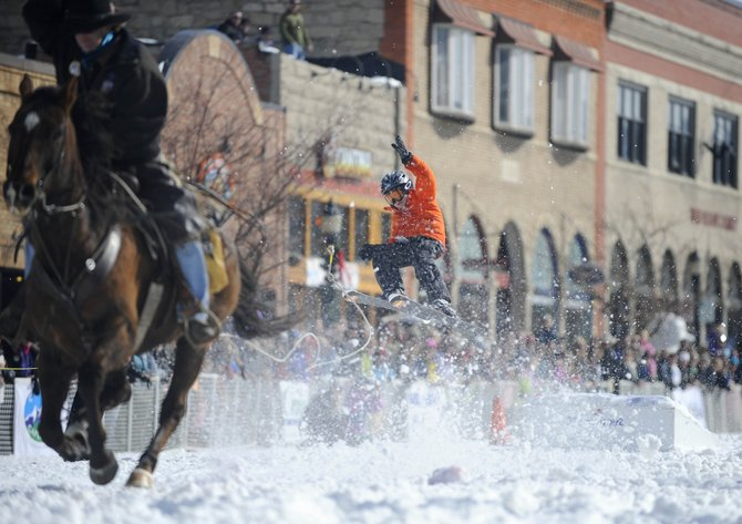 Asher Lesyshen-Kirlan competes in the skijoring event during the Winter Carnival street events Saturday. He won the competition.