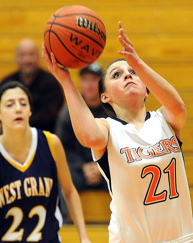 Hayden senior Jenn Bugg puts up a shot Saturday. The Tigers had little trouble as they ran over West Grand.
