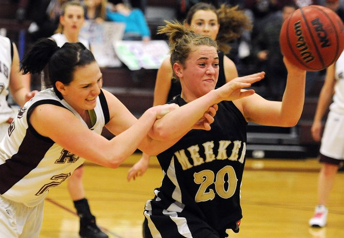 Soroco's Shelby Miles tries to get a hand on the ball Saturday against Meeker. The Rams got a big lead early but couldn't hold off the Cowboys' second-half surge.
