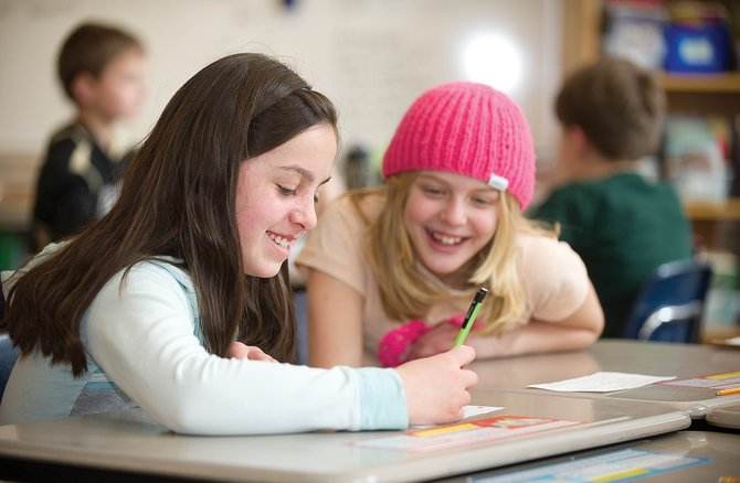 Fourth-graders Lauren Ehrlich, left, and Ava Scarborough work on a project during class Monday afternoon at Soda Creek Elementary School. Routt County School District leaders are welcoming the news that Colorado has earned a waiver from the federal No Child Left Behind Act.