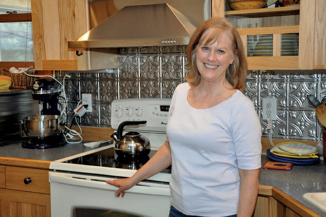 Deborah Behringer stands in the kitchen of her Craig home where she and her friend, Elaine Gray, made chocolate mocha truffles for Saturday's Taste of Chocolate event in downtown Craig. Ticket holders voted Behringer's creation as the best in the contest.
