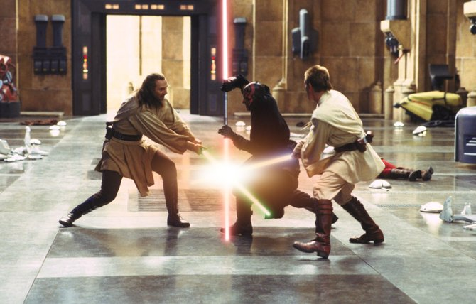 "Jedi Knight Qui-Gon Jinn (Liam Neeson), left, and student Obi-Wan Kenobi (Ewan McGregor), right, duel with Darth Maul (Ray Park) in ""Star Wars Episode I: The Phantom Menace."" The movie, newly remastered and distributed in 3-D, is the first chronological entry in the ""Star Wars"" series and sets up the story of how young Anakin Skywalker eventually becomes Darth Vader."