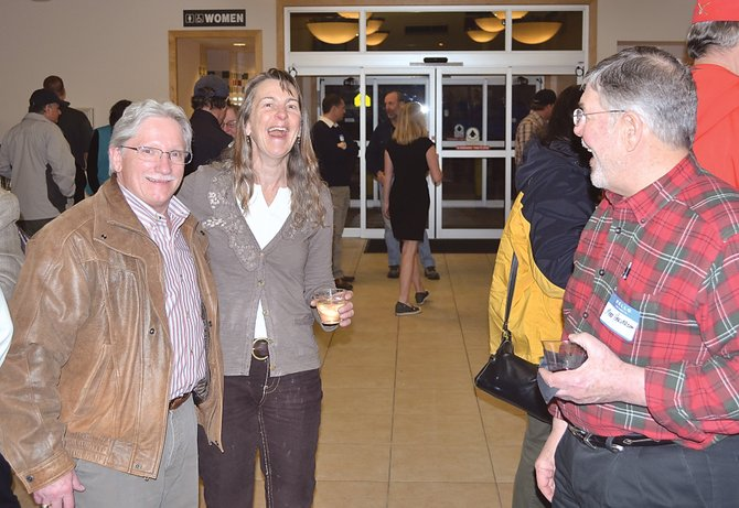 Routt County Manager Tom Sullivan, left, Steamboat Ski and Resort Corp. Airline Director Janet Fischer and Yampa Valley Airport Commissioner Mark Halvorson celebrate the dedication of the final phase of the 11-year terminal expansion project at Yampa Valley Regional Airport on Wednesday night.