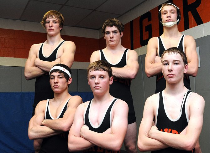 The Hayden High School wrestling team qualified seven wrestlers to this weekend's Class 2A state championship in Denver. Between, from bottom left, T-Lane Mazzola, Kaiden Decker, Kent Miller, Ryan Domson, top left, Chad Terry, Journey Vreeman and Nick Williams, not pictured, the squad hopes to haul home medals and hopefully even a state championship or two.