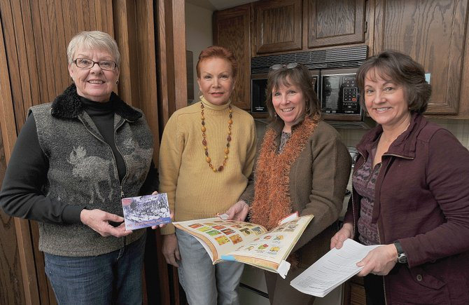 Several local residents — including, from left, Eileen Grover, Jackie Grimaldi, Nancy Mucklow and Karen Massey — have been working on a cookbook to commemorate the 100th anniversary of the Routt County Fair.