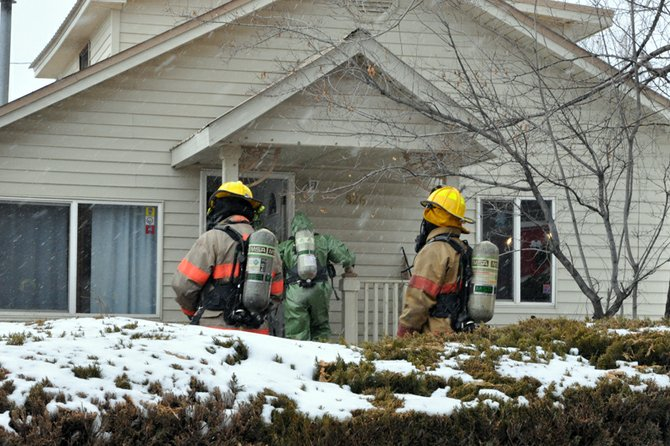 "Craig Fire/Rescue firefighters and members of the Moffat County Hazmat Team prepare Friday to enter a home at 826 Colorado St., a vacant residence believed to contain the remnants of a dormant methamphetamine lab. ""At this point, we have no idea who was responsible"" for creating the lab, said Marvin Cameron, All Crimes Enforcement Team commander."