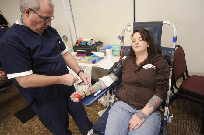 Phlebotomist Chuck Fleming draws Jodee Dike's blood Thursday at Yampa Valley Medical Center.